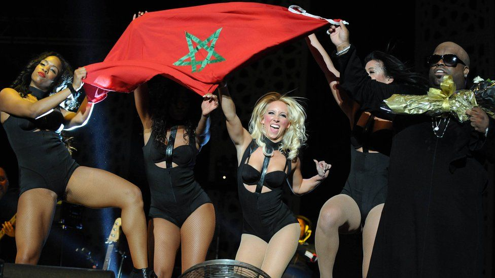 US singer Ceelo Green and dancers hold up the Moroccan flag during Mawazine festival in 2013.