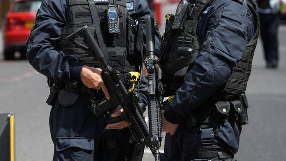 Armed police stand guard near London Bridge station following an attack in the capital, 4 June 2017