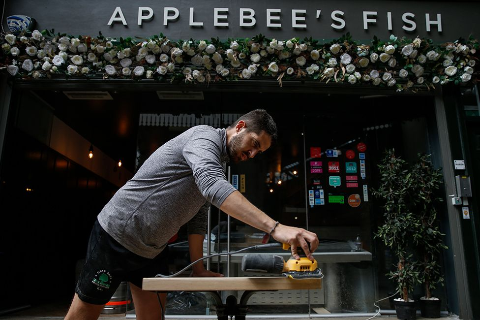 Preparations at Applebee's Fish to take dining outside