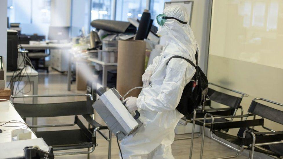 PSS worker bio-fogging office