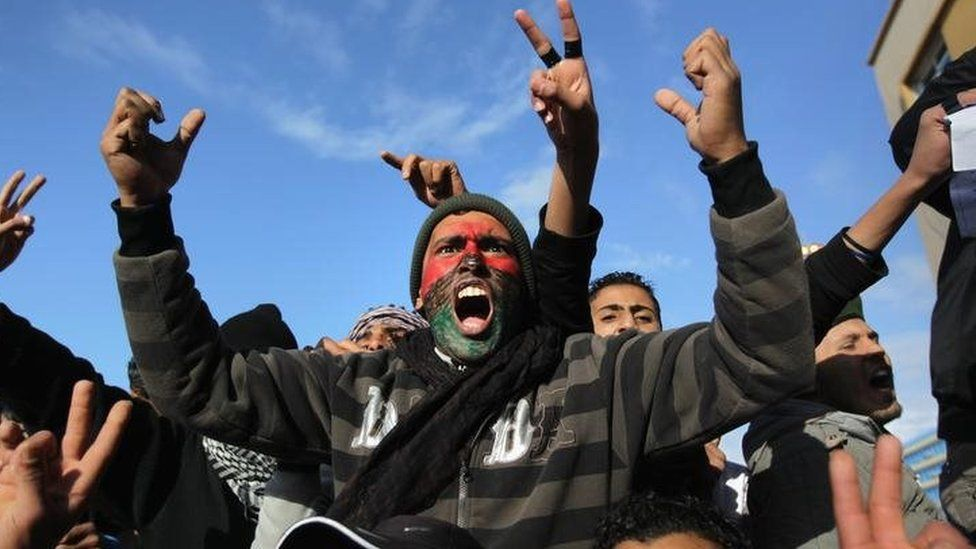 Demonstrators demand the removal of Libyan leader Muammar Gaddafi on February 24, 2011 in Benghazi, Libya