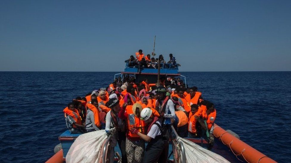 Migrants are rescued by members of the Aquarius rescue ship in the Mediterranean Sea