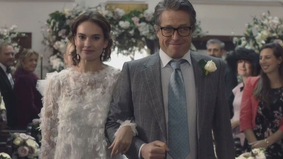 Lily James and Hugh Grant