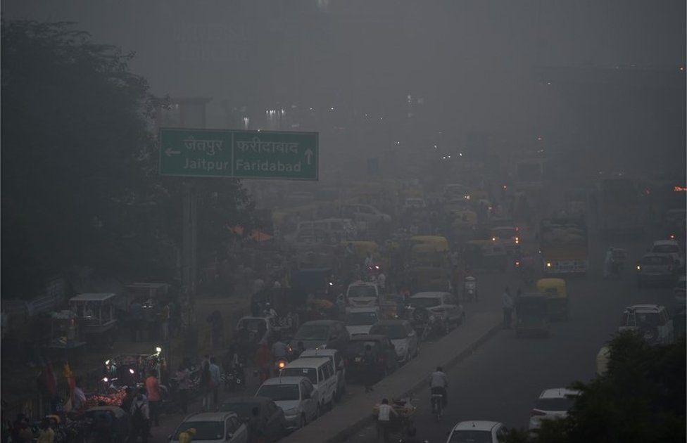 Traffic is seen through heavy smog in New Delhi on November 8, 2017.