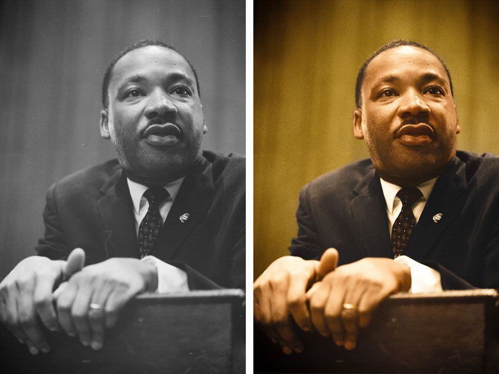 Dr. Martin Luther King leans forward over a podium