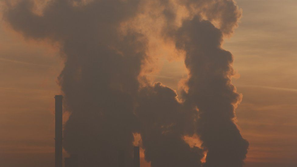 The sun sets behind a power plant powered by coal in the Bosnian town of Tuzla