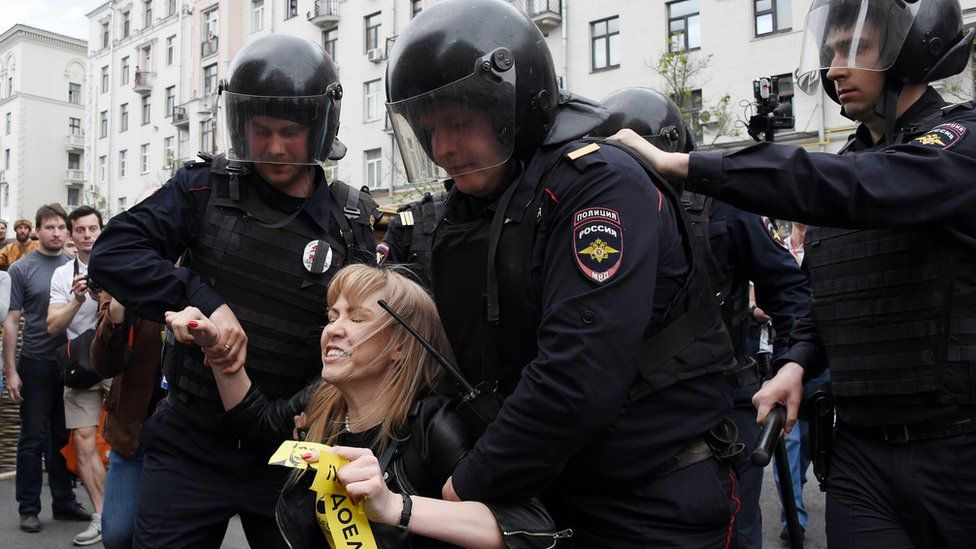 Russian police officers detain Maria Baronova of Open Russia at the opposition rally in Tverskaya street in central Moscow