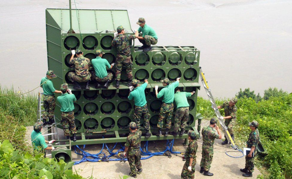 Army engineers assemble a huge speaker stack near the DMZ.