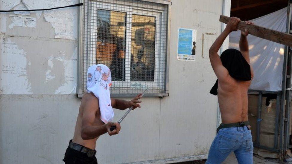 Refugees attack a housing facility at the Moria camp. Photo: 29 September 2019