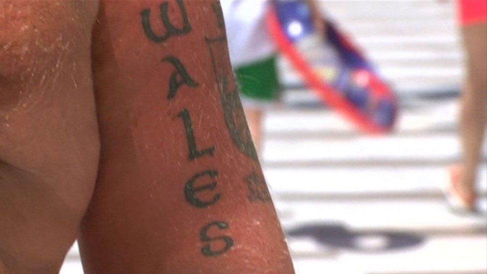 Benidorm man with Wales tattoo