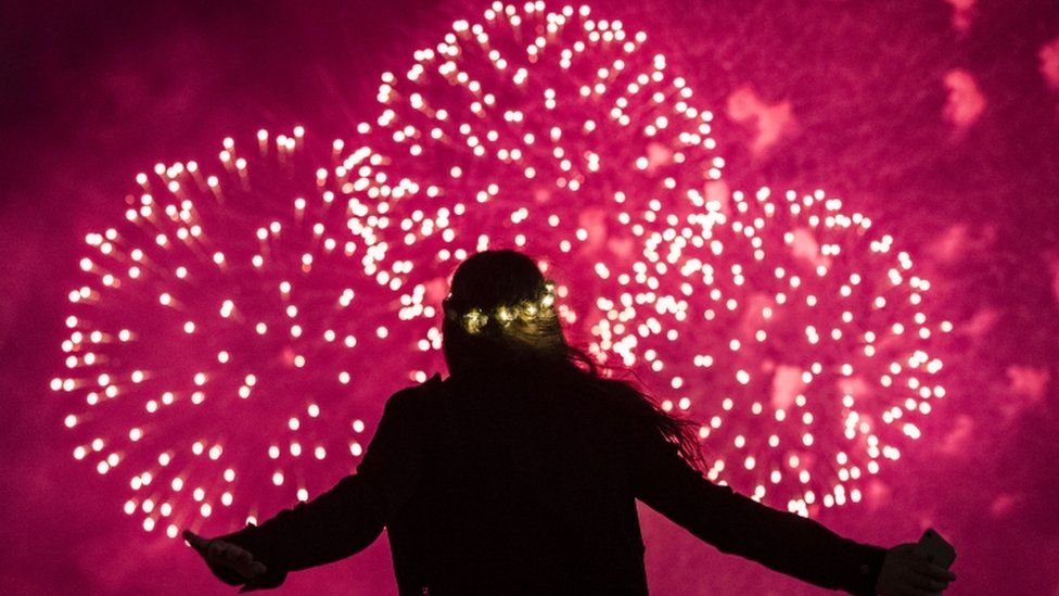 A young girl watches fireworks display during New Year celebrations in Sydney, Australia