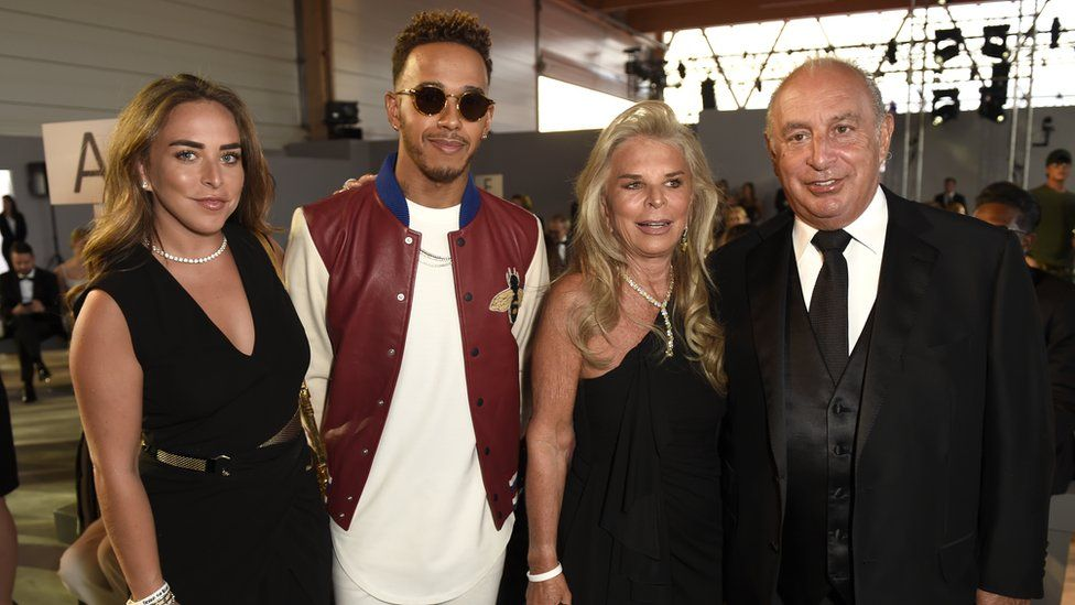 Sir Philip Green, right, with his daughter Chloe, F1 driver Lewis Hamilton, and his wife Tina