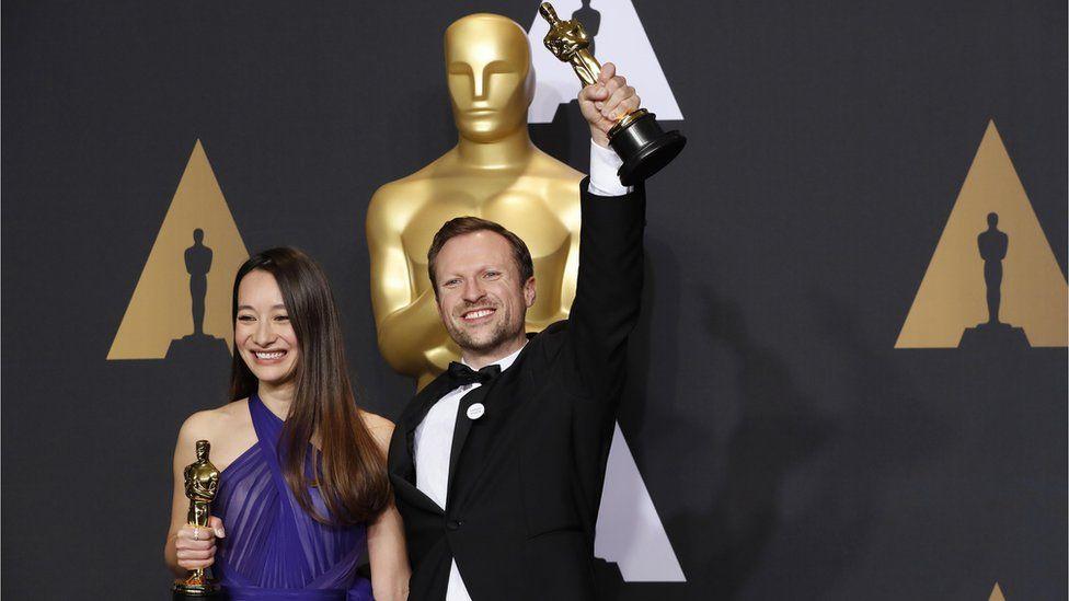 Producer Joanna Natasegara and director Orlando von Einsiedel after the awards with their Oscars