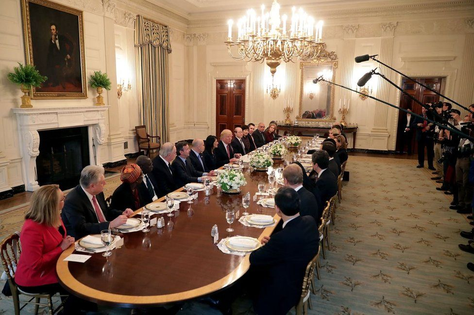 Donald Trump and UN delegates in the State Dining Room in April 2017
