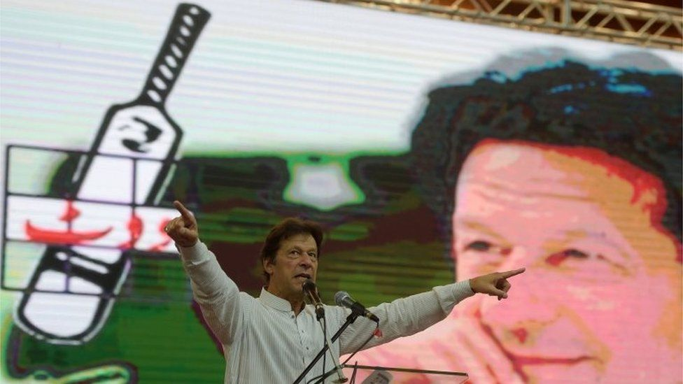 In this picture taken on June 30, 2018, Pakistan cricketer-turned politician Imran Khan of the Pakistan Tehreek-e-Insaf (Movement for Justice) speaks to supporters during an election campaign rally in Islamabad