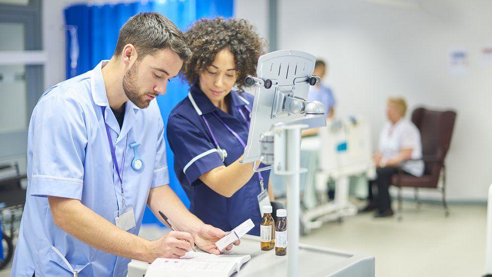nurses filling in prescription