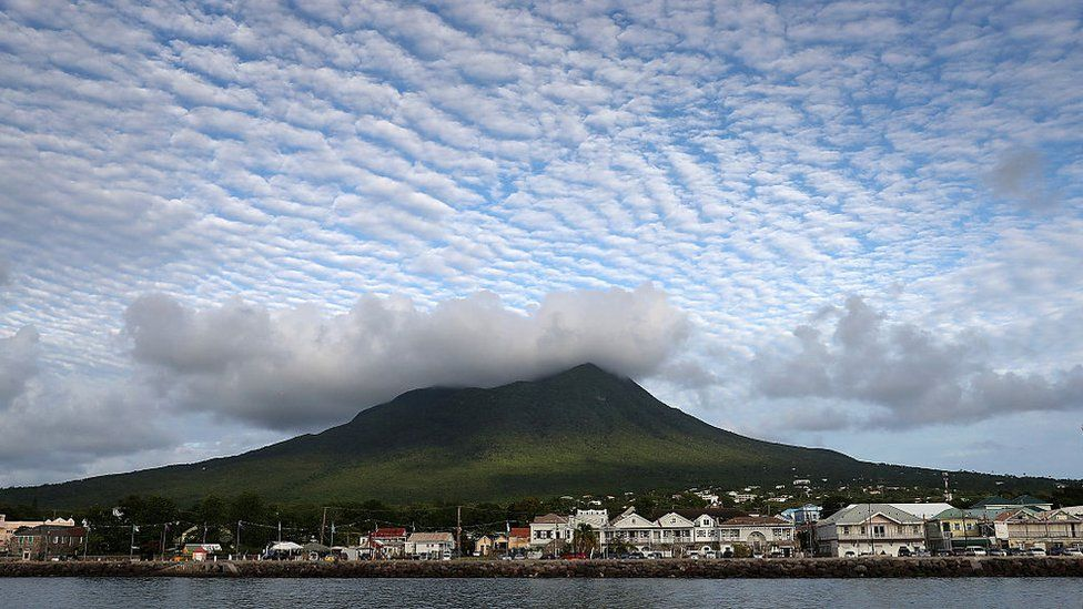 Cloud formations over a volcanic peak on Nevis, St Kitts and Nevis