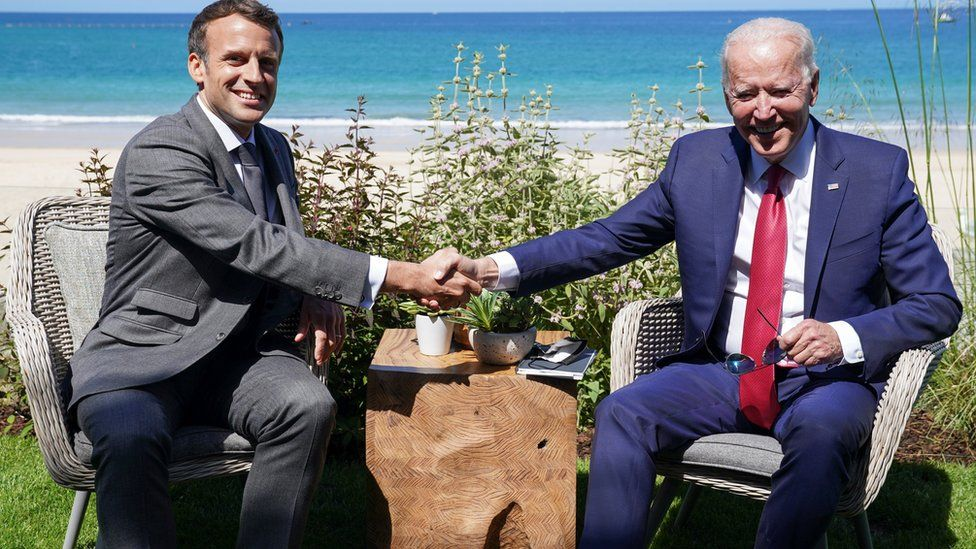 """U.S. President Joe Biden and France""""s President Emmanuel Macron shake hands as they attend a bilateral meeting during the G7 summit in Carbis Bay, Cornwall, Britain"""