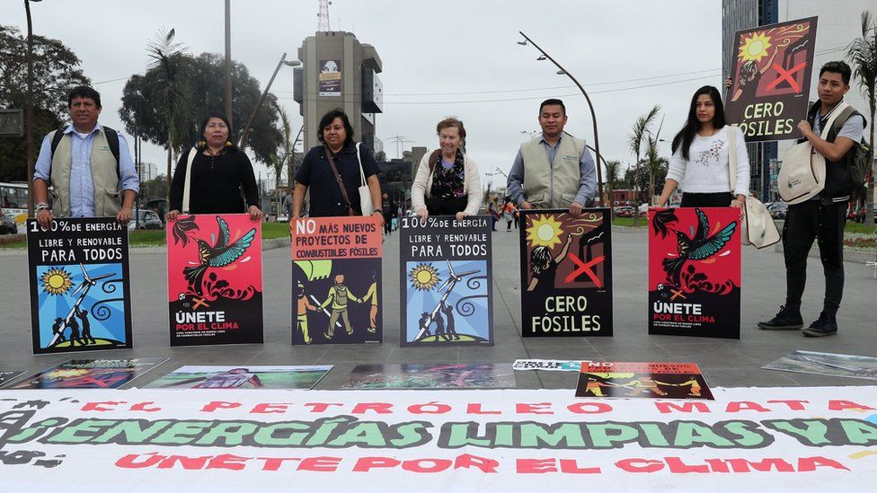 Activists gather to urge world leaders to take action against climate change in Lima, Peru on 8 September 2018.