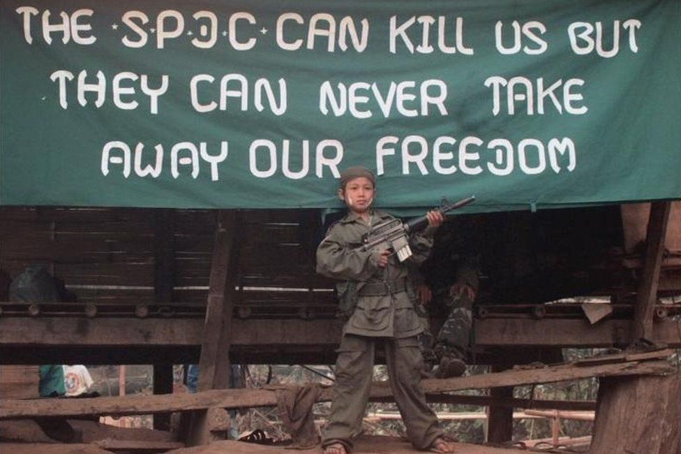 A young Karen soldier poses with a gun in January 2000, to celebrate the 51st Anniversary of the KNU's Revolutionary Day