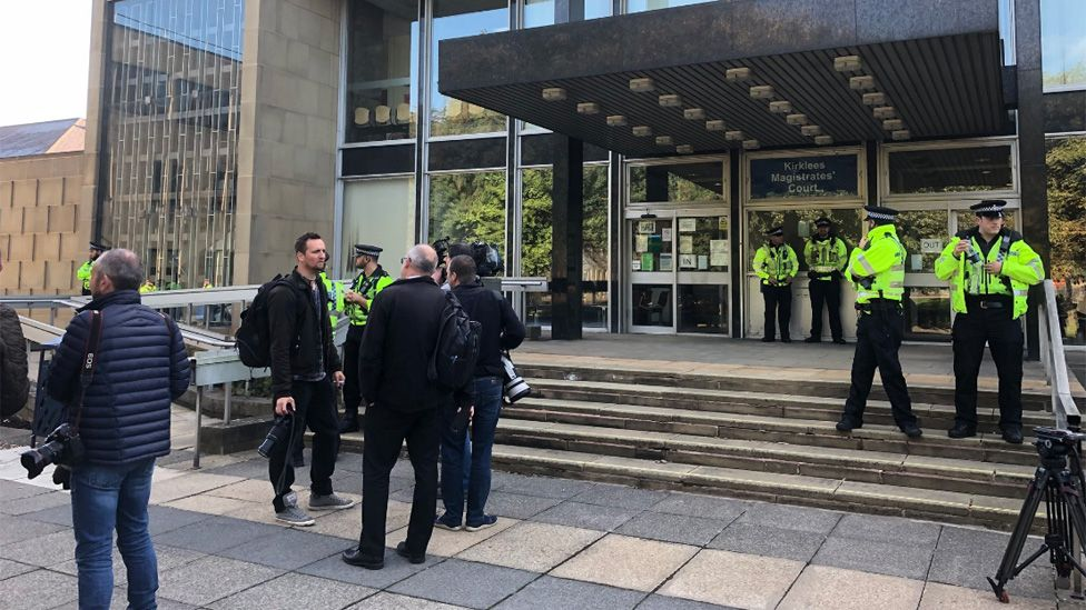 Police and press outside court