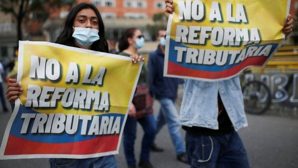"Demonstrators hold banners reading ""No to the tax reform"" as they take part in a protest against the tax reform of President Ivan Duque""s government in Bogota, Colombia April 28, 2021"