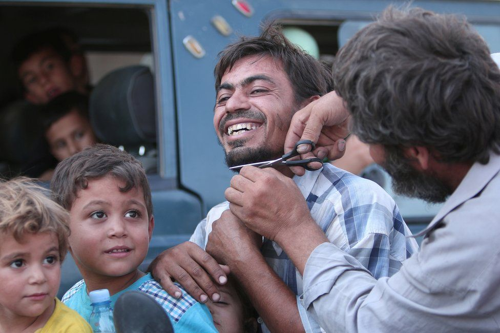 Civilians evacuated from an Islamic State-controlled neighbourhood of Manbij, Syria, 12 August