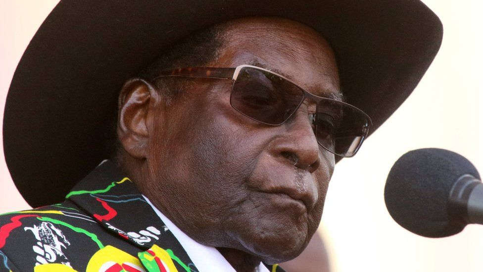 Robert Mugabe addresses supporters of his ruling ZANU (PF) party gathered for a rally in Chinhoyi
