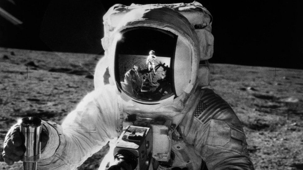 Astronaut Alan Bean holds a sample container during the Apollo 12 mission in this Nasa handout photo. November 19, 1969.