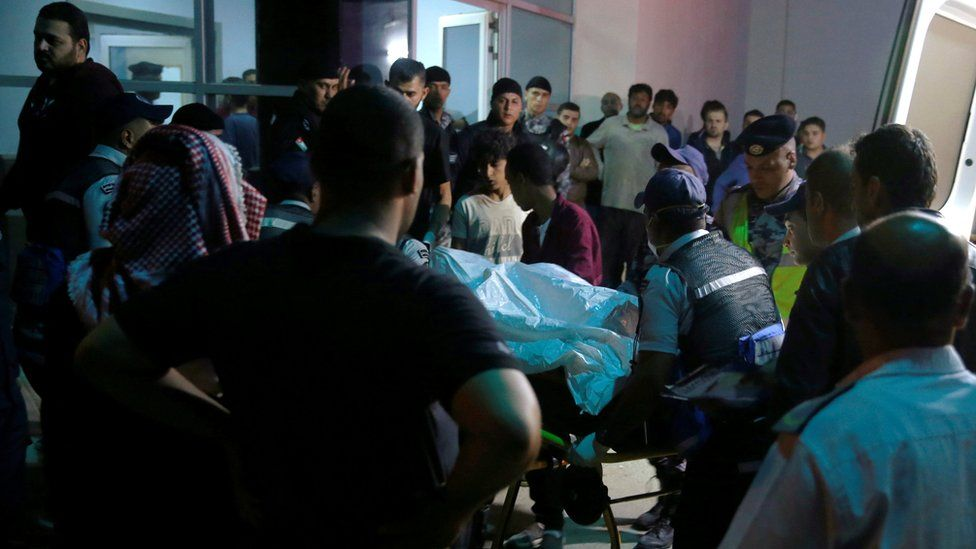 Injured person at hospital as relatives of victims wait