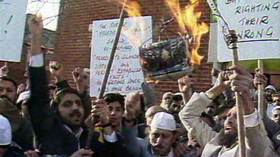Protesters burn a copy of Salman Rushdie's The Satanic Verses at a protest in Blackburn, 1989