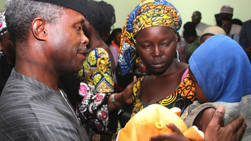 One of the 21 freed Chibok girls cries