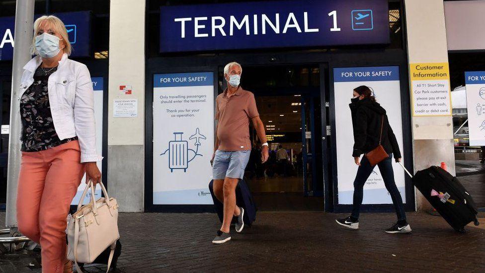 People leaving airport terminal