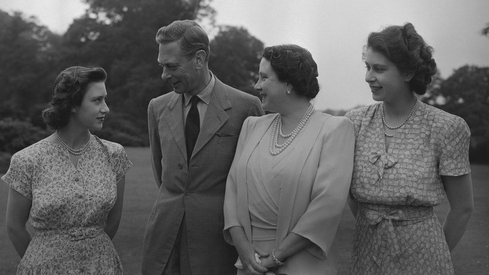 Princess Margaret (1930-2002), King George VI (1895-1952), Queen Elizabeth, The Queen Mother (1900-2002) and Princess Elizabeth (Queen Elizabeth II) in the grounds of Windsor Castle, Berkshire, 8 July 1946