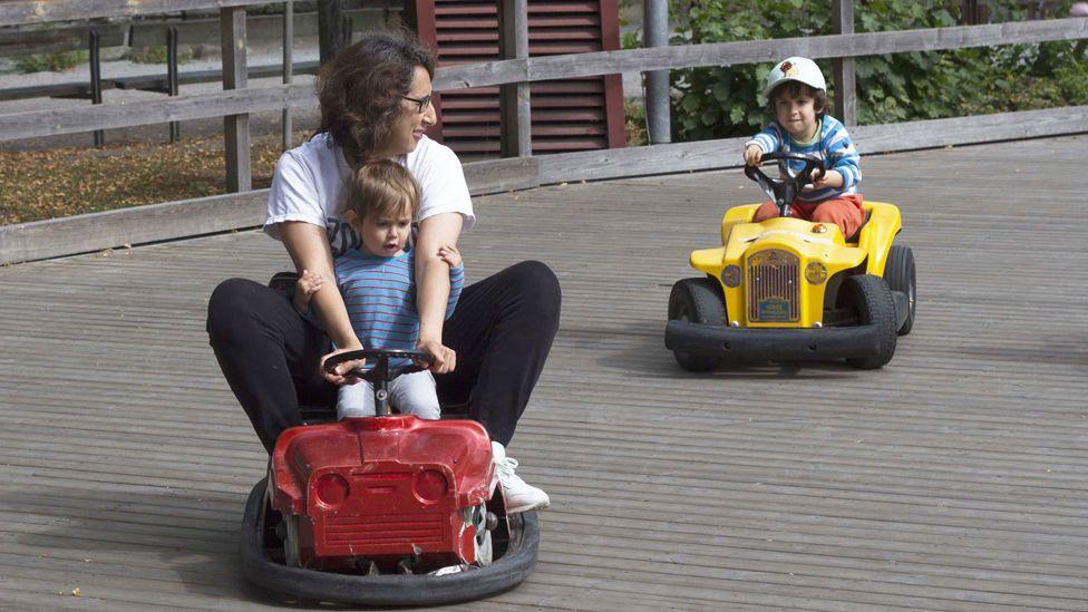 Alejandra Fuentes and her children driving go-karts
