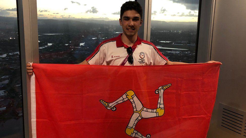Jake Kelly holding Manx flag