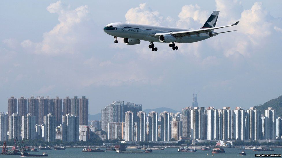 In this picture taken on August 10, 2014, a Cathay Pacific passenger plane prepares to land at Hong Kong's international airport.