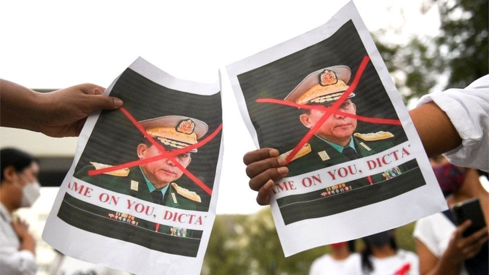 Banners decrying the general as a dictator