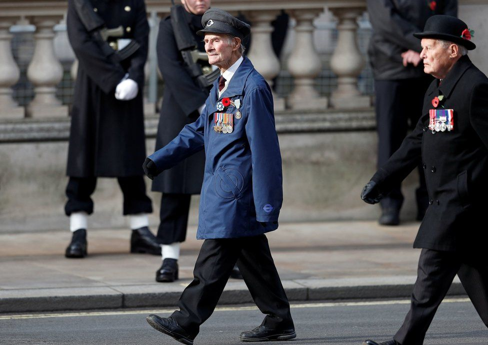 D-Day veteran John Aichison, 96, (centre)attends the Remembrance Sunday service at the Cenotaph, in Whitehall, London.