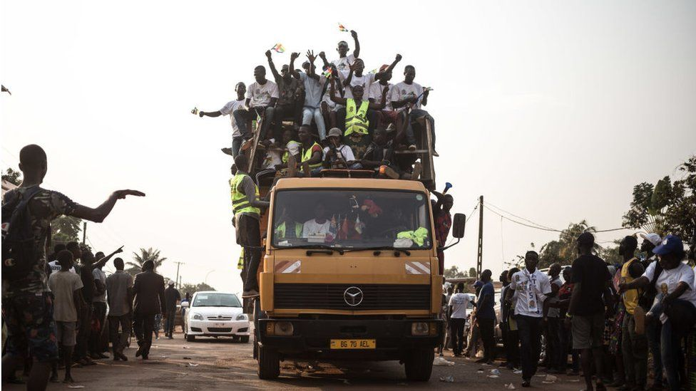 Supporters of the incumbent Central African republic president President Faustin-Archange Touadera, arrive at the headquarters of his party, the Movement United Hearts (MCU) after the announcement of the validation of the results of the presidential election of December 27, 2020 by the Constitutional Court in Bangui, on January 18, 2021.