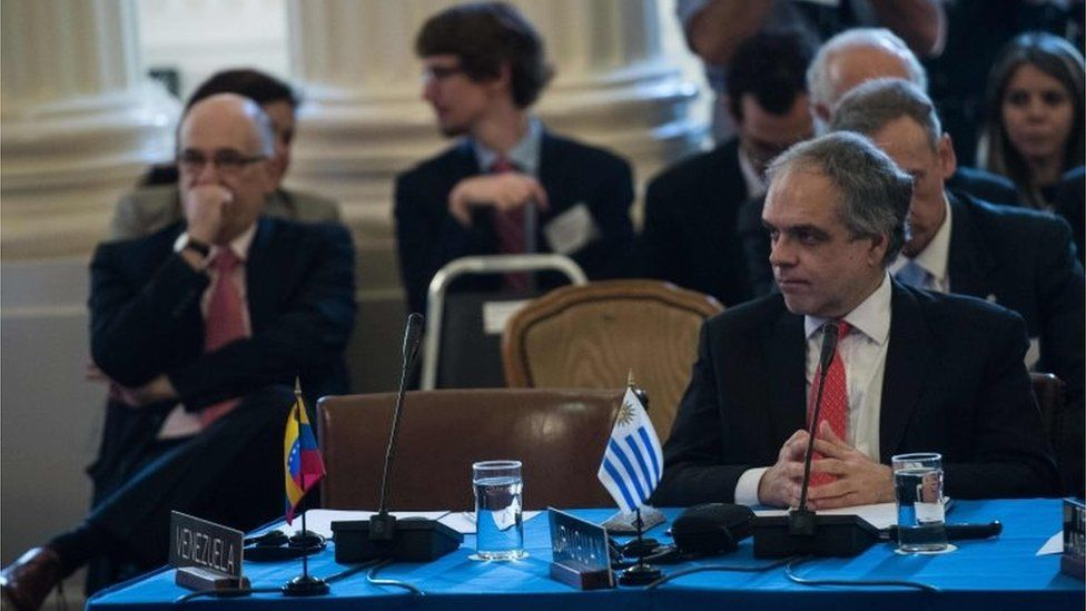 Uruguay's Under Secretary for Foreign Affairs Jose Luis Cancela sits next to Venezuela's empty seat during an OAS foreign ministers meeting on Venezuela in Washington, DC, on May 31, 2017.