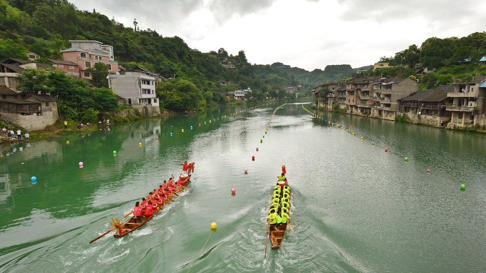 Teams compete during a dragon boat race in Huangping in China's southern Guizhou province in June 2017