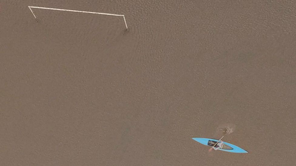 Canoe on a football pitch