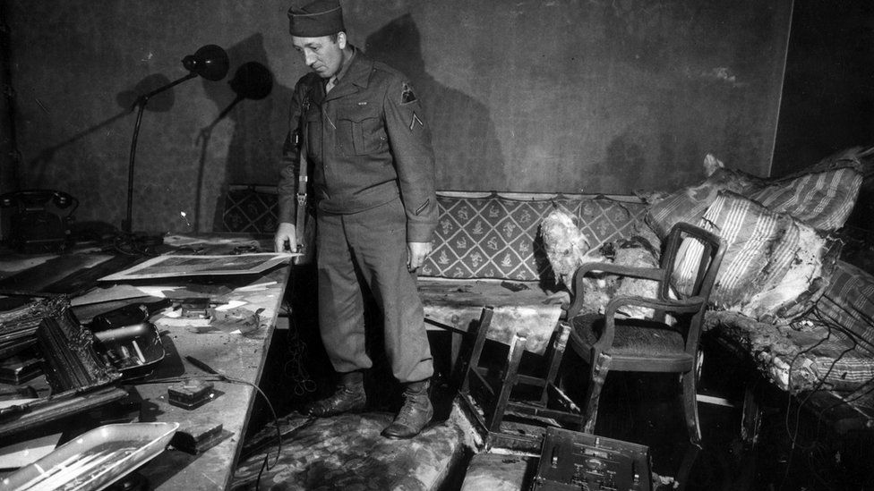 US soldier inside fire-ravaged bunker in 1945