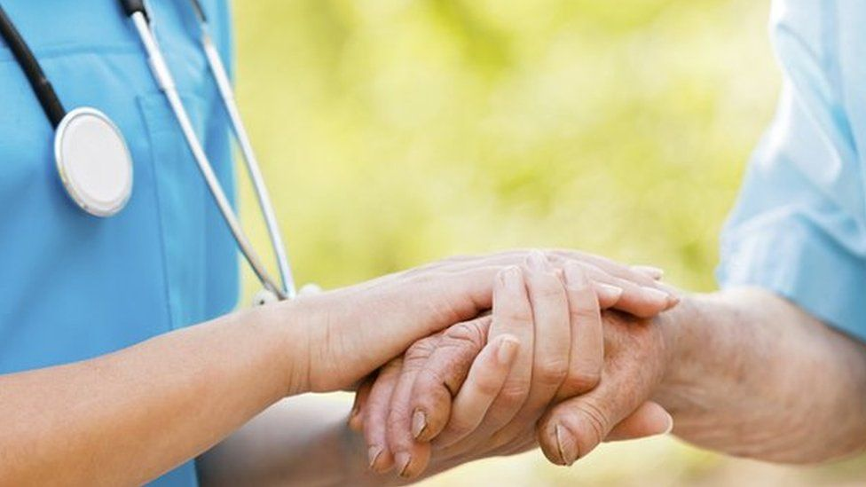 A nurse with a patient (stock image)