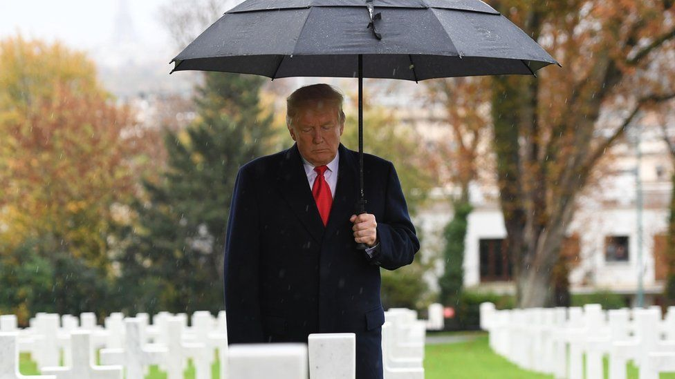 US President Donald Trump takes part in a ceremony at the American Cemetery of Suresnes, outside Paris