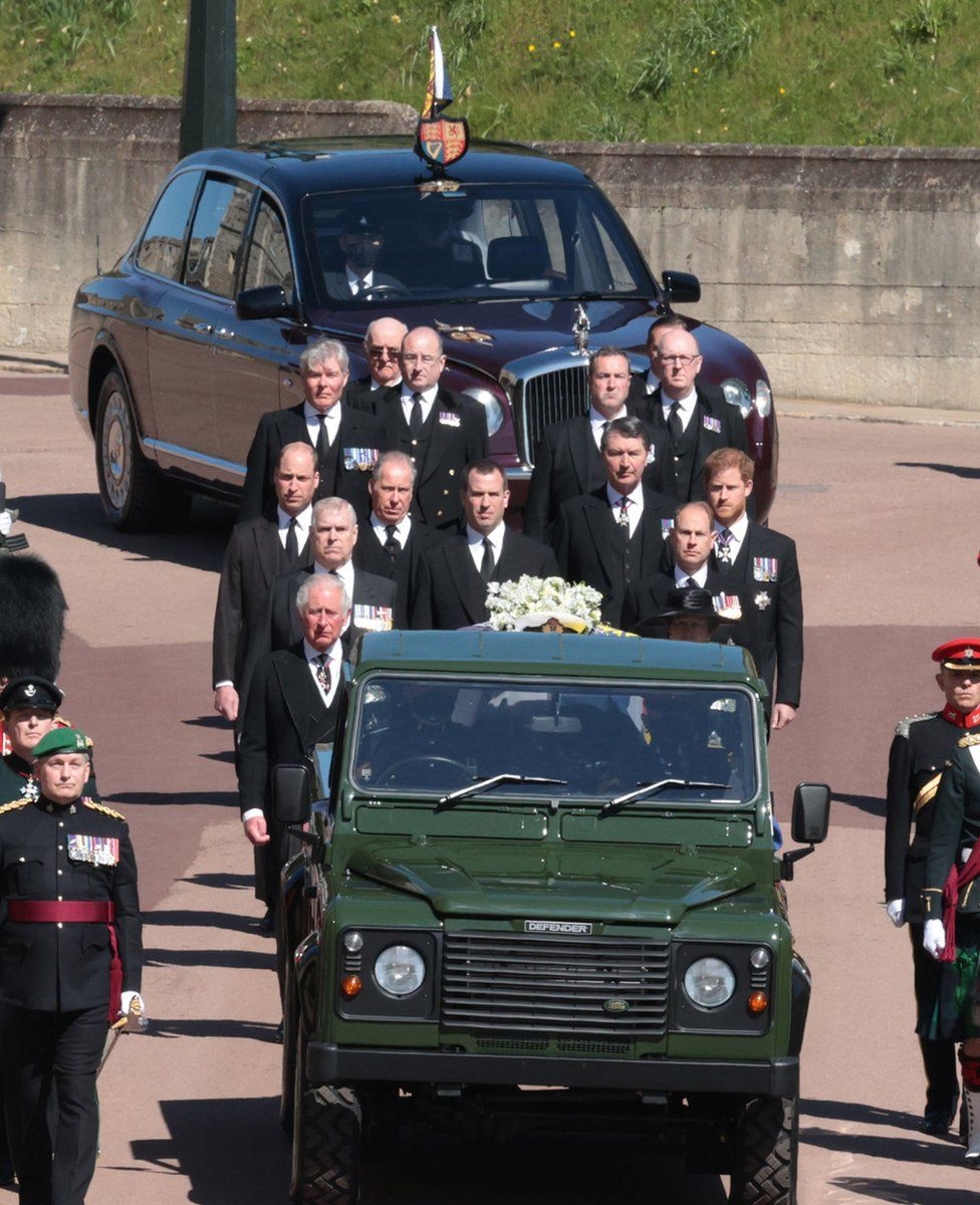 Queen Elizabeth in the Bentley State Limousine and members of the Royal Family follow the hearse during the funeral of Britain's Prince Philip, who died at the age of 99, on the grounds of Windsor Castle in Windsor, Britain, April 17, 2021.