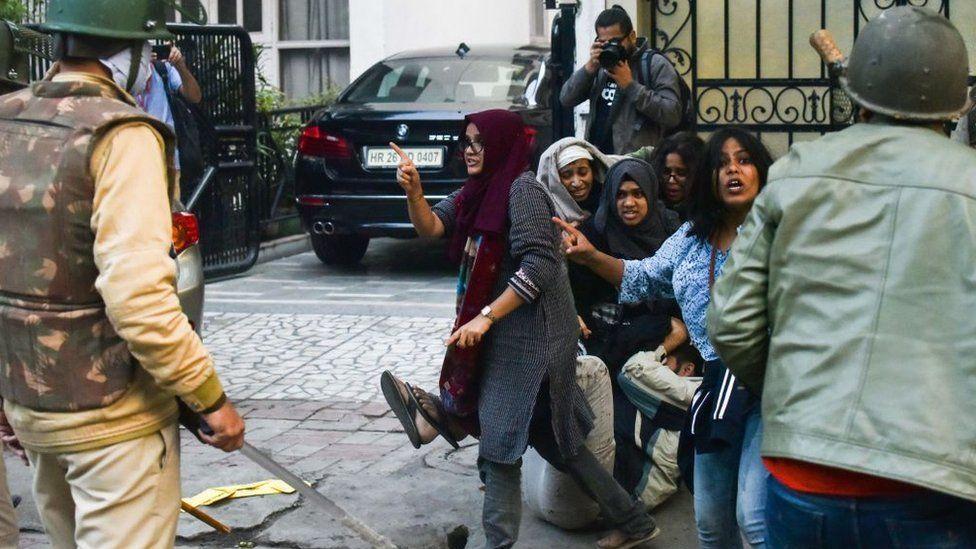 Students of Jamia Millia Islamia react during a protest against Citizenship Amendment Act