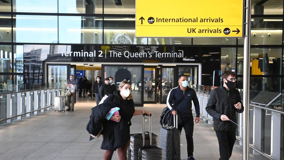 Passengers arrive at Heathrow Airport in January