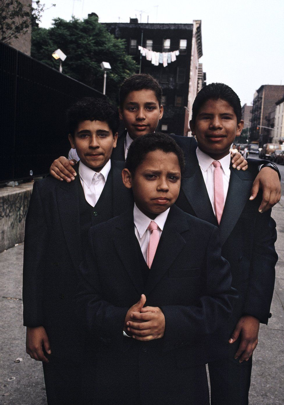 A group of young men in suits